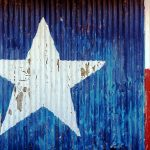A photograph of a painted Texas state flag